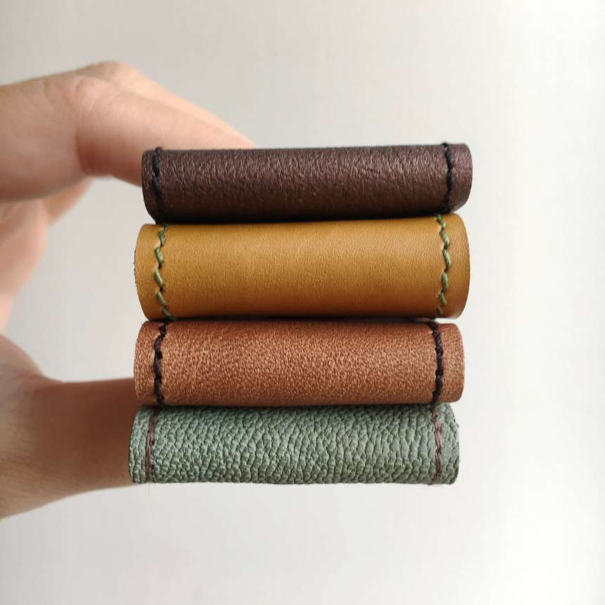 Leather_bookmarks_autumn_colours_by_law